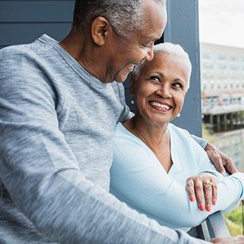 older black couple smiling together