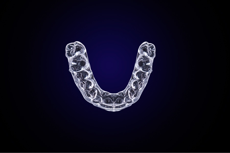 Aerial view of Invisalign aligners against a blue background