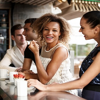 woman having coffee with friends